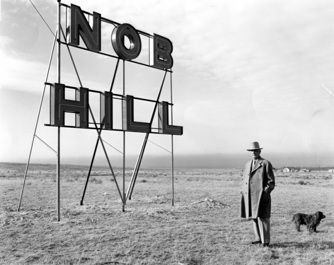 1938 | D.K.B. Sellers with his dog and Nob Hill sign